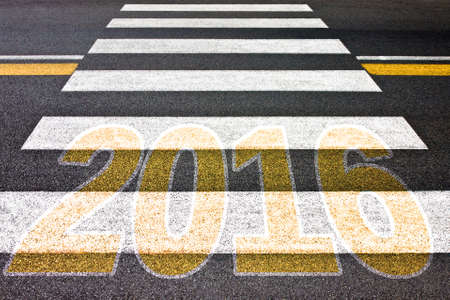 bisiness: Going toward 2016 - Pedestrian crossing with 2016 written on it - concept image Stock Photo