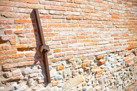 steel plate: Restoration of the facade of an old italian masonry building with metal tie-rod and anchor plate
