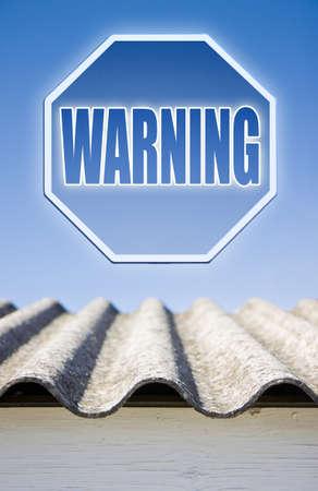 carcinogen: Warning asbestos concept. Warning asbestos on road sign