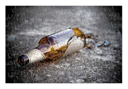 disjoint: Puzzle of a broken bottle of beer resting on the ground - Free themselves from alcohol addiction - concept image - Toned image