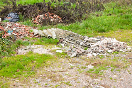 criminal activity: Illegal dumping with asbestos abandoned in nature Stock Photo