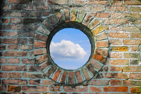 confined space: A round window where you see the sky - Freedom concept image