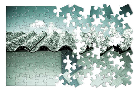 removing the risk: Asbestos removal concept image - Image in puzzle shape