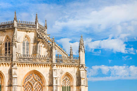buttresses: Detail of the facade of Batalha cathedral in Portugal (Europe) - image with copy space
