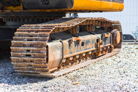 Detail of the track of a digging machine and moving earth at construction site Stock Photo