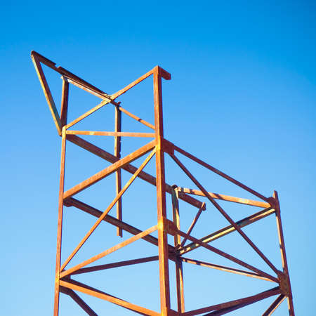 assemblage: Old iron structure on blue background - image with copy space Stock Photo