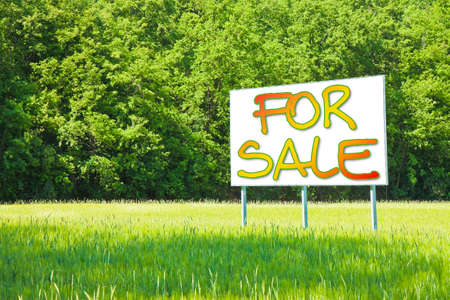 informs: Billboard informs that the land is free to be sold Stock Photo