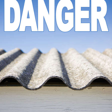 Dangerous asbestos roof detail.  Useful image to be used on white backgrounds where the writing is joined to the background.