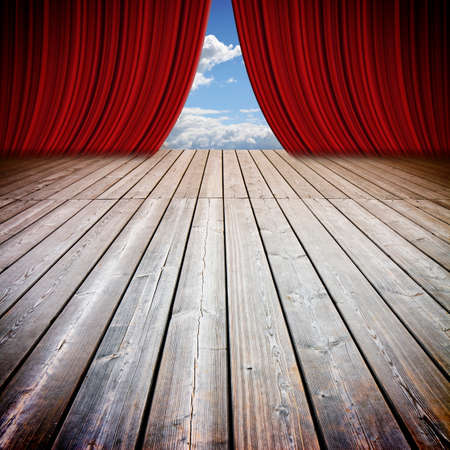 Open theater red curtains and wooden floor against a cloudy sky - concep timage