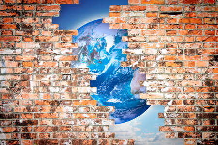 rupture: Through a cracked wall you can see the world - freedom concept image