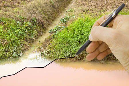 Hand draws a graph about seasonal rainfall - concept image