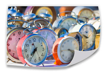 Time passes inexorably - Old colored metal table clocks - concept image