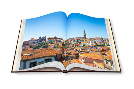 Oporto panoramic view on opened photobook isolated on white background. On background the famous Clerigos tower Stock Photo