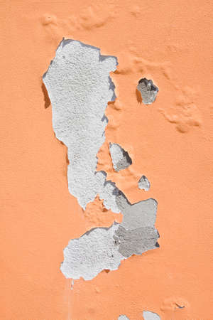 Damaged colored plaster - concept image useful image also to express the concepts of: aging, decadence, aging of human skin and so on