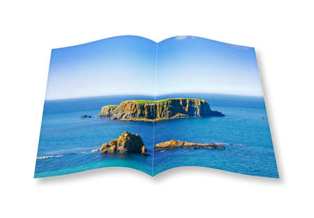 3D render of an opened photo book with a small rocky island in the middle of the northern Ireland sea Stock Photo