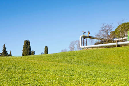 Geothermal power plant in Tuscany hills (Italy) - Image with copy space Stock Photo