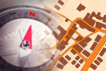 Finding the right home for you! - Concept image with a city map, buildings, roads and navigational compass Stock Photo