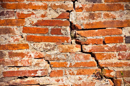 the collapsing: Deep crack in old brick wall - concept image with copy space Stock Photo