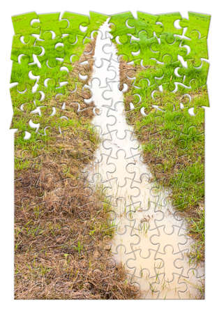 Full water ditch in a field after torrential rain - concept image in puzzle shape