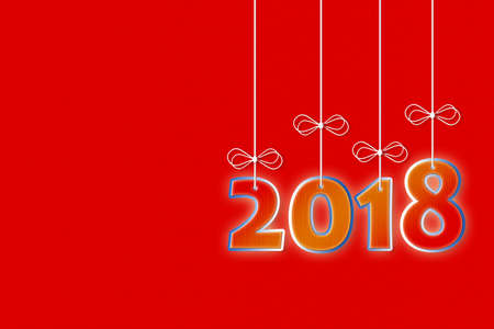 Happy 2018 concept image with hanging numbers on red cardboard - image with copy space Stock Photo