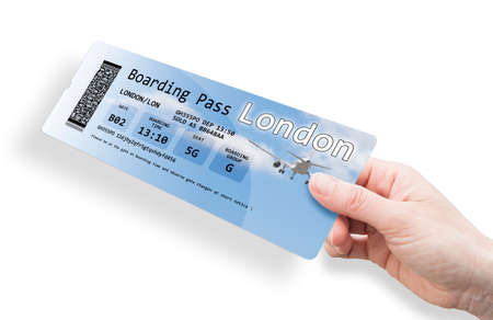 Hand of a woman holding a airplane ticket to London - image isolated on white.