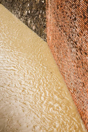Brick wall for containing a water channel