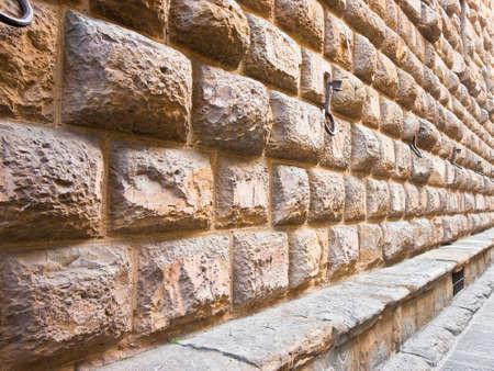 フィレンツェのメディチ・リカルディ宮殿の石垣の詳細:ルネッサンス建築の壮大な例(イタリア・トスカーナ・フィレンツェ)