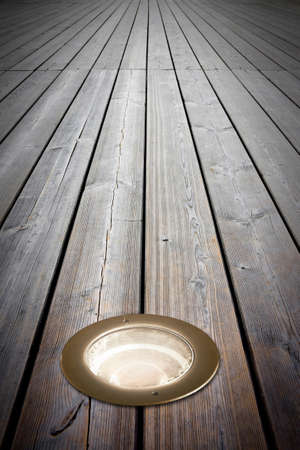 Recessed floor lamp on old wooden floor - image with copy space Stok Fotoğraf