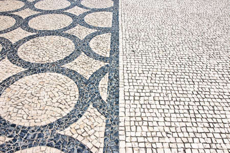 Typical Portuguese floor. Typical Portuguese floor made of small pieces of colored stone in shape of circles and arcs