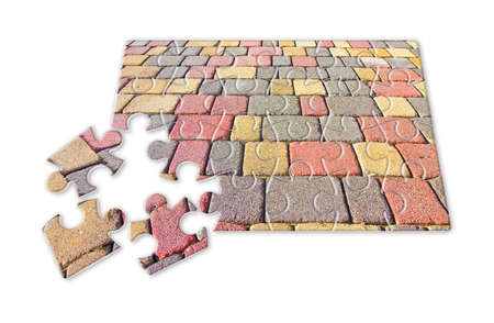 Colored concrete flooring, permeable to water, assembled on a substrate of sand - concept in puzzle shape