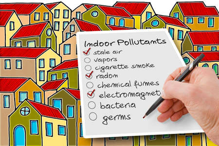 Hand write a check list of indoor air pollutants against a buildings background - concetp image with copy space