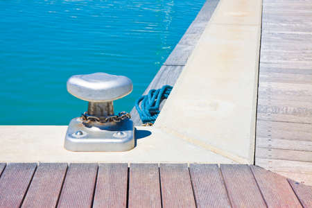 Cleat for mooring boats on wooden platform - image with copy space