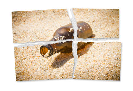 Ripped photo of a bottle of beer resting on the beach - Alcoholism and tobacco addiction concept