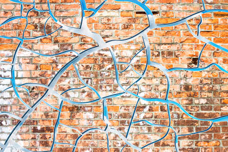 Abstract graphic image with cloudy sky behind a cracked brick wall
