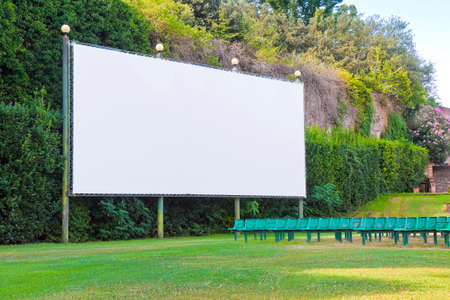 Outdoor cinema with white projection screen