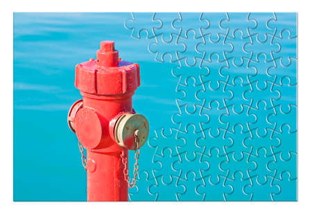 Manage your fire prevention plan - Red fire hydrant against a water background  - concept image in jigsaw puzzle shape