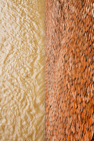 Brick wall for containing a water channel - concept image