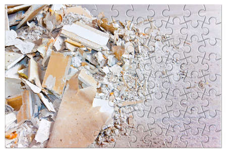 Plasterboard products recycling - Concept image with demolished plasterboard wall in jigsaw puzzle shape