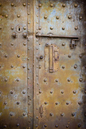 Old closed medieval metal door - concept image
