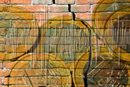 Financial earthquake concept image - Italian euro coins group against a cracked brick wall