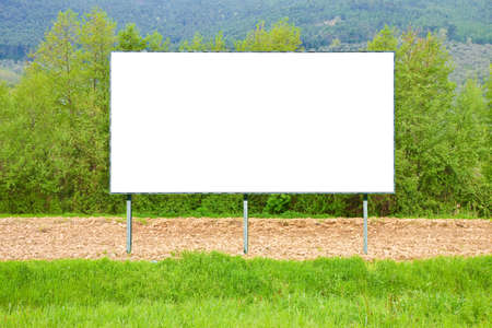 Blank commercial advertising billboard immersed in a rural scene - image with copy space Фото со стока