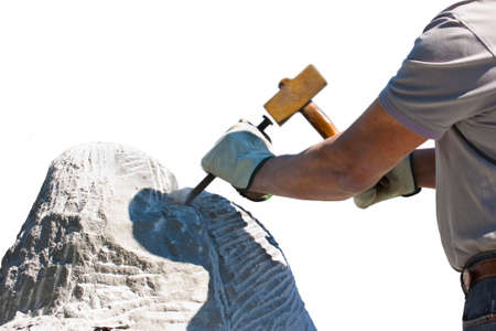 Sculptor man at work with hammer and protective gloves to carving a stone block on white background for easy selection Stockfoto