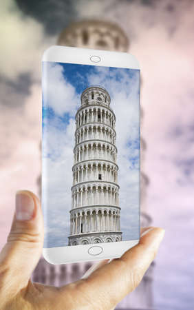 Hand holding a smartphone with the famous Leaning Tower (Italy - Pisa) - 3D render concept image Stock Photo
