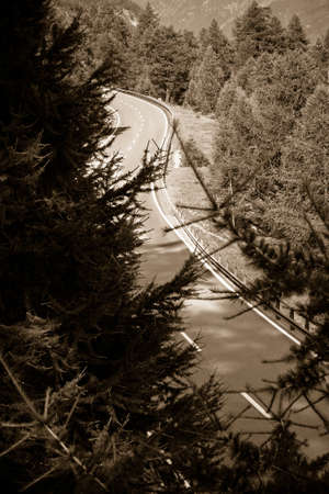 Winding Road in sepia toned with copy space - Switzerland Mountain Road
