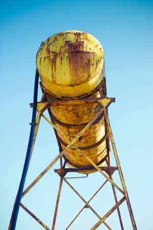 Ol rusty yellow tank of an abandoned factory Stock Photo