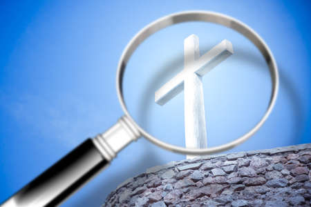 Looking for faith - concept image with a magnifying glass in front of a Christian cross
