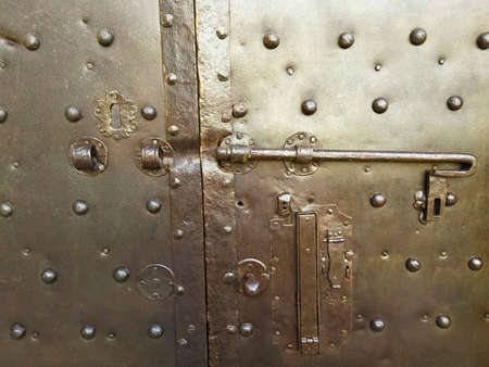 Old closed metal door - Security and protection concept - toned image Stock Photo