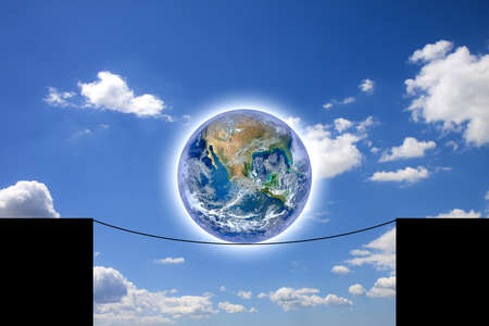 The world balancing on a rope - concept with image from NASA