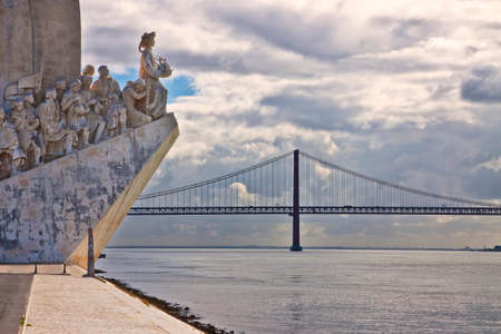 Monument to the Discoveries (Padrao dos Descobrimentos) at the Tagus river with view on 25th of April Bridge (Lisbon - Portugal)