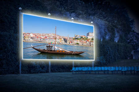Typical portuguese wooden boats, called -barcos rabelos- used in the past to transport the famous port wine towards the cellars of the city (Portugal - Europe) - Outdoor cinema concept image